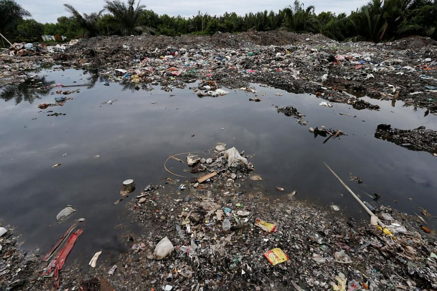 A plastic waste dumping site at an oil palm plantation in Telok Panglima Garang, Malaysia, on Oct 14, 2018.