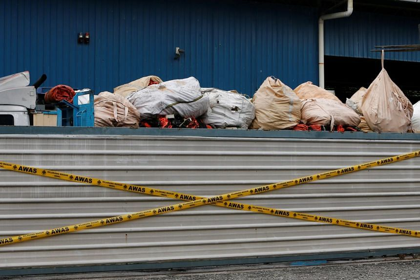 Plastic waste piled on a truck in an illegal recycling factory sealed off by the authorities in Jenjarom, Kuala Langat, on Oct 14, 2018.