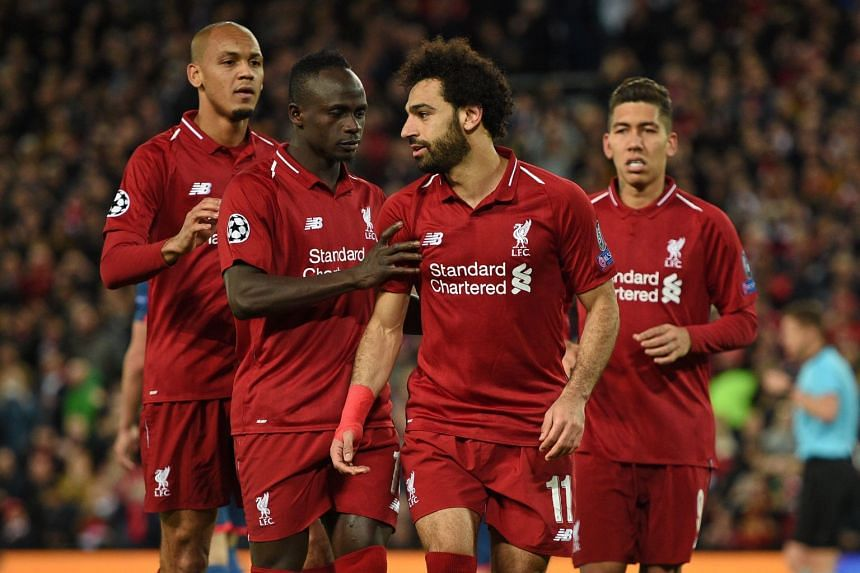 Salah (second right) celebrates with team mates after scoring Liverpool's third goal from the penalty spot.