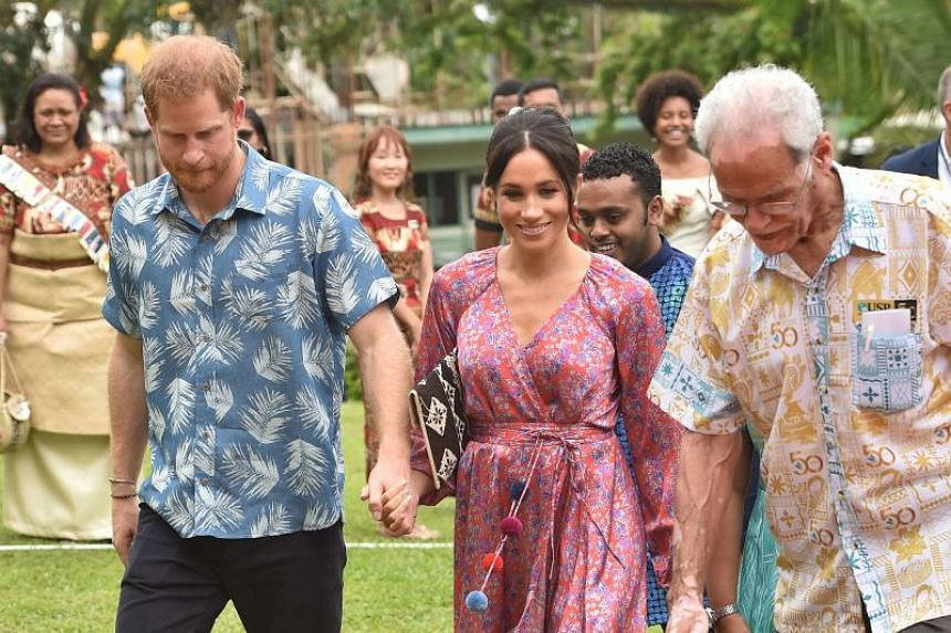 Britain's Prince Harry and his wife Meghan, Duchess of Sussex, arrive at the University of the South Pacific in Suva, on Oct 24, 2018.