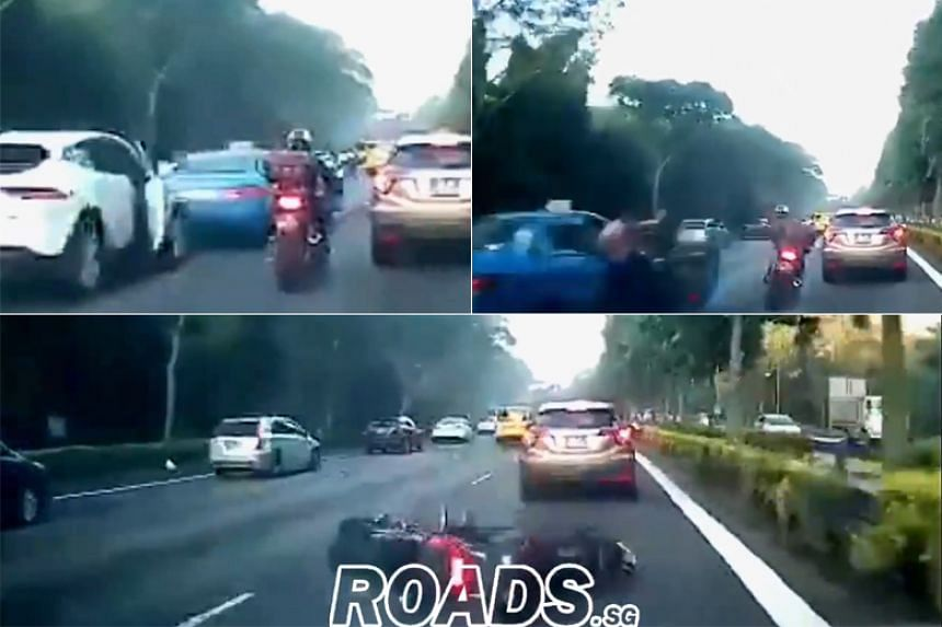 A video posted on Facebook group Roads.sg shows a Comfort taxi driver stepping out of his cab, just as a motorcyclist rides past him.