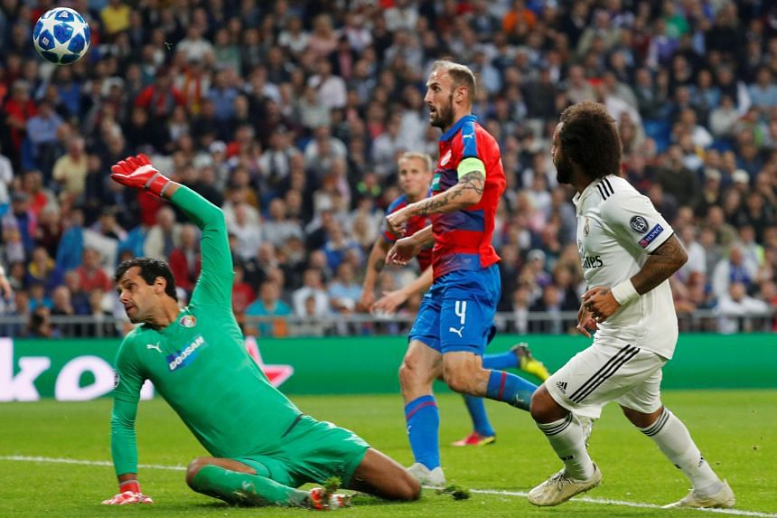 Real Madrid's Marcelo (right) scoring his team's second goal against Viktoria Plzen to win 2-1 and end their five-game winless streak.
