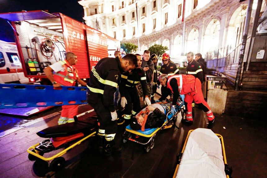 A victim being evacuated after an escalator leading to a metro station collapsed with many Russian football fans on it