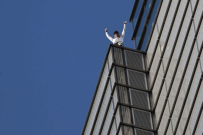 Robert reacts as he reaches the top of Heron Tower in central London.