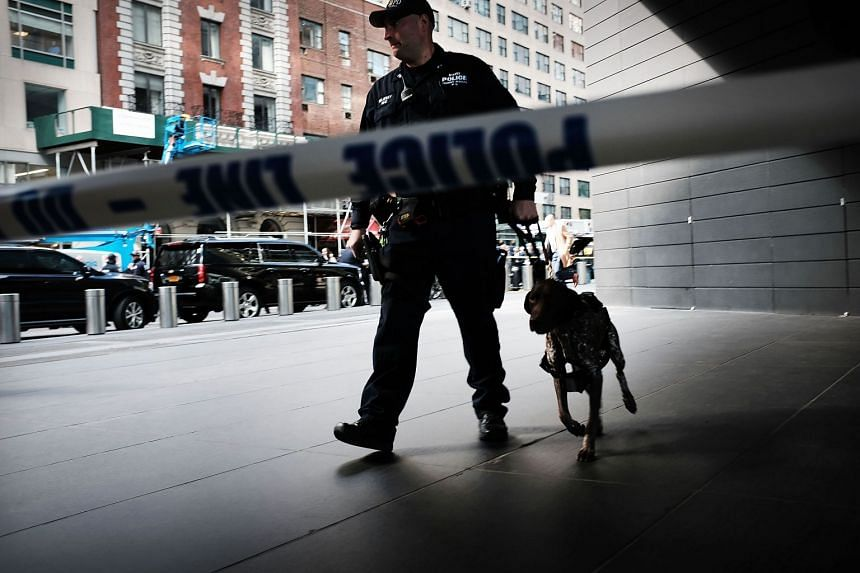 Police stand guard outside the Time Warner Centre after an explosive device was found there.
