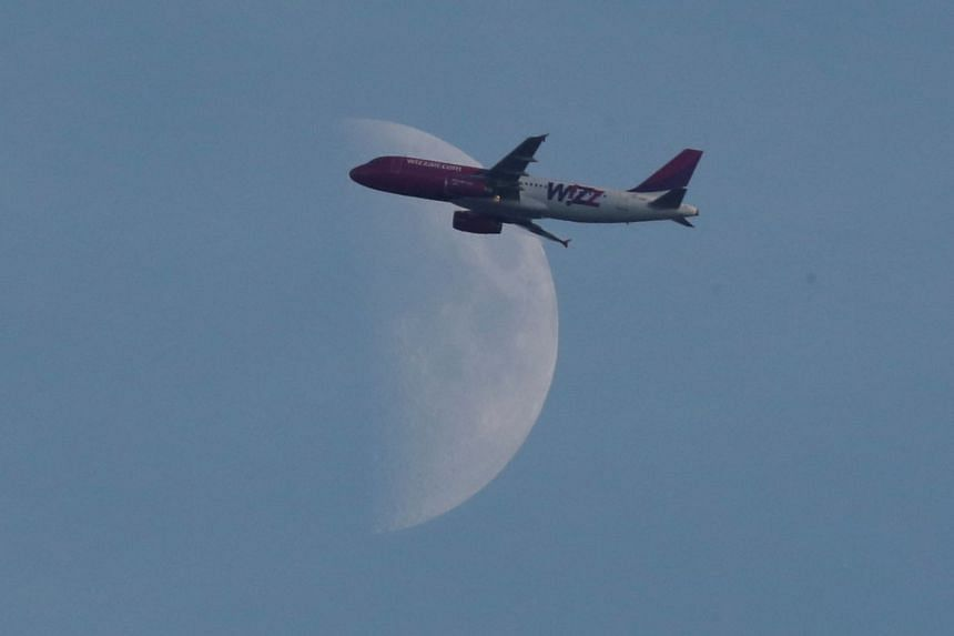 A Wizz Air plane flying over Britain in September 2018.