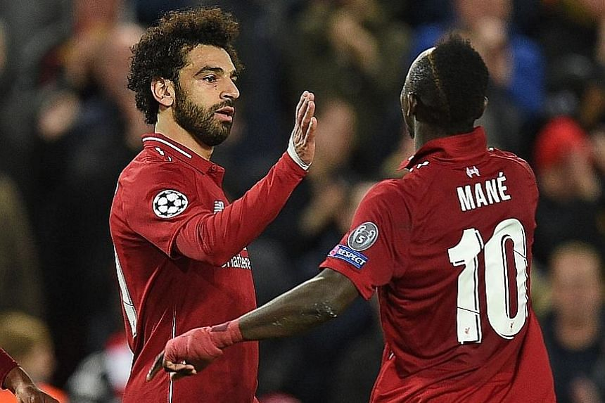 Liverpool's Egyptian forward Mohamed Salah celebrating with Senegalese striker Sadio Mane after scoring their second goal in the Champions League match against Red Star at Anfield on Wednesday.