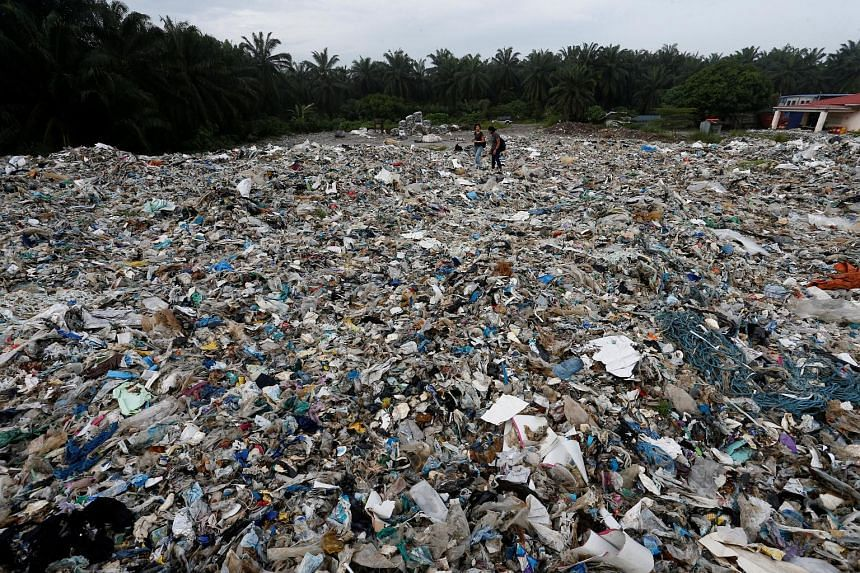Above: Plastic waste outside an illegal recycling factory in Jenjarom in Kuala Langat, Malaysia, earlier this month. Left: An illegal plastic recycling factory in Pulau Indah. Many illegal plants use low-end technology and environmentally harmful met