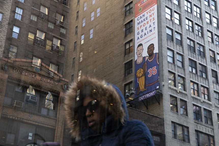"A billboard depicting Kevin Durant and Kristaps Porzingis in matching blue jerseys, reads ""Can You Make NY Sports Great Again?"" outside of Madison Square Garden in New York, on Oct 25, 2018."