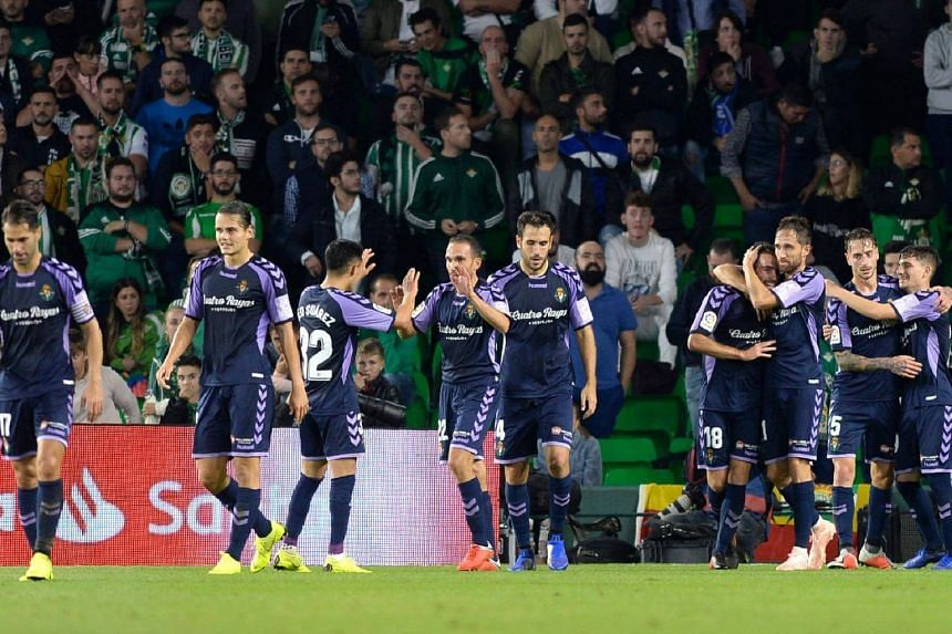 Real Valladolid's Spanish defender Antonito (third from right) celebrates with teammates after scoring a goal during the Spanish league football match against Real Betis at the Benito Villamarin stadium in Sevilla, on Oct 21, 2018.