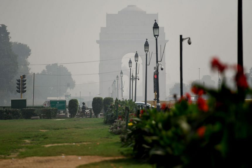 A view of India Gate during heavy smog conditions in New Delhi, on Oct 25, 2018.