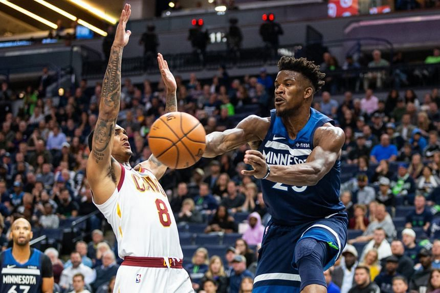 Minnesota Timberwolves' forward Jimmy Butler passes the ball against Cleveland Cavaliers' guard Jordan Clarkson during the fourth quarter at Target Centre on Oct 26, 2018.