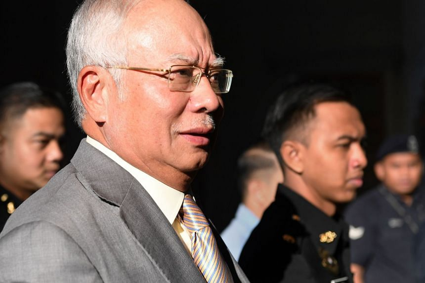 Former Malaysian prime minister Najib Razak escorted by police to the courthouse in Kuala Lumpur, on Oct 25, 2018.