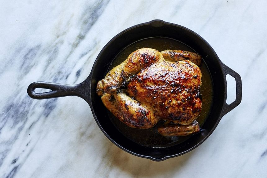 A roast chicken with maple butter and rosemary. The natural sugars in maple syrup caramelise in this recipe, turning the chicken's skin a nutty brown.