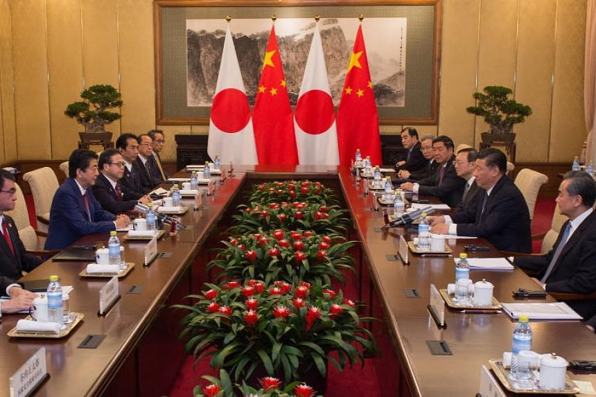 Japan's Prime Minister Shinzo Abe (2nd from Left) speaks with China's President Xi Jinping (2nd from Right) during a meeting at the Diaoyutai State Guesthouse in Beijing, China, on Oct 26, 2018.