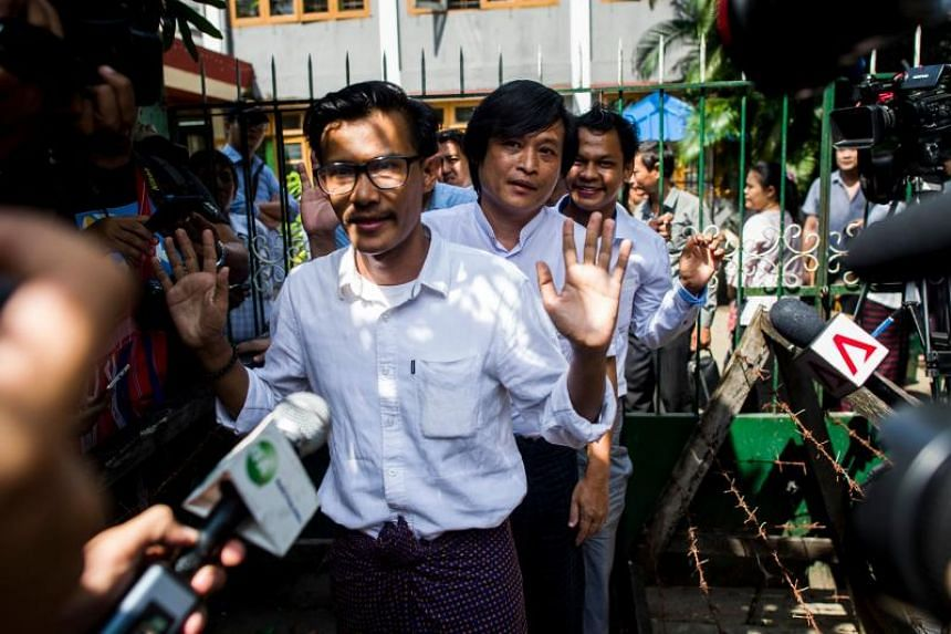 Detained Myanmar journalists Kyaw Zaw Lin (front) followed by Nayi Min and Phyo Wai Win leave the court compound after a hearing in Yangon, on Oct 26, 2018.