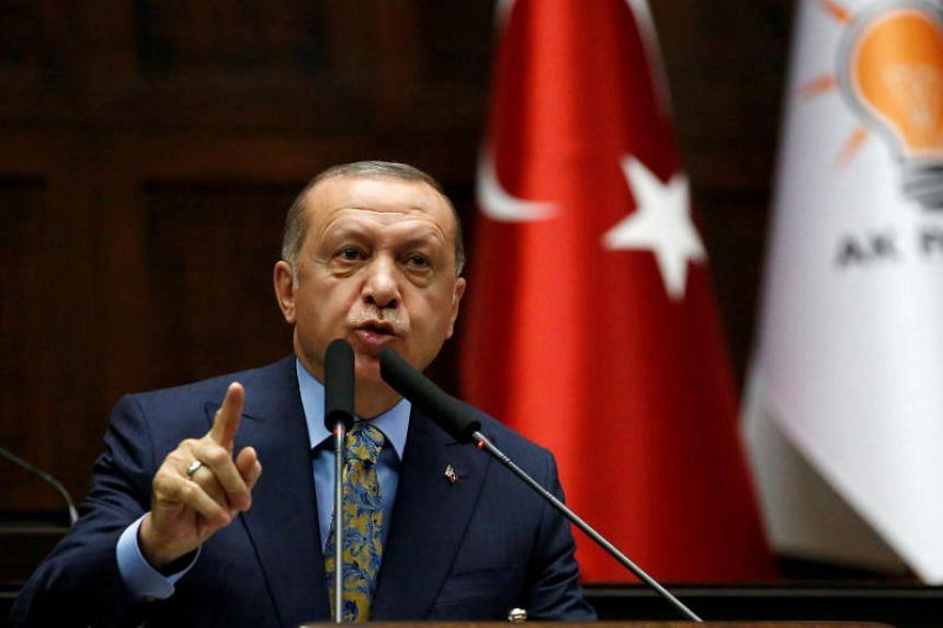 Turkish President Recep Tayyip Erdogan addressing Members of Parliament from his ruling AK Party in Ankara, Turkey, on Oct 23, 2018.