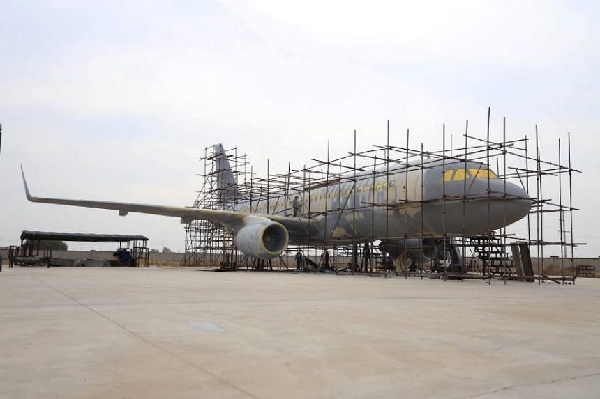 The full-scale replica of the Airbus A320 is now nearly finished, permanently parked on a short piece of tarmac surrounded by wheat fields in north-east China.