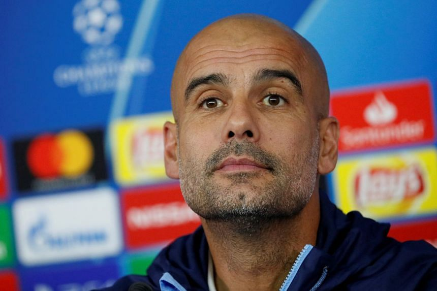 Guardiola (above) says his league leaders will have a far tougher fight on their hands to defend their title this season.