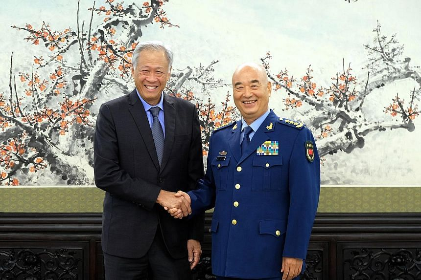 Singapore's Defence Minister Ng Eng Hen meeting General Xu Qiliang, vice-chairman of China's Central Military Commission, in Beijing yesterday. They discussed deepening military cooperation.