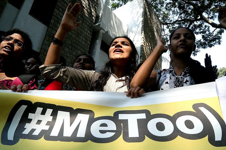 Members of the All India Mahila Samskrutika Sanghatane joined students from different colleges in holding placards as they shouted slogans on Thursday, after attending a #MeToo convention in Bengaluru, India, demanding that the security and dignity o