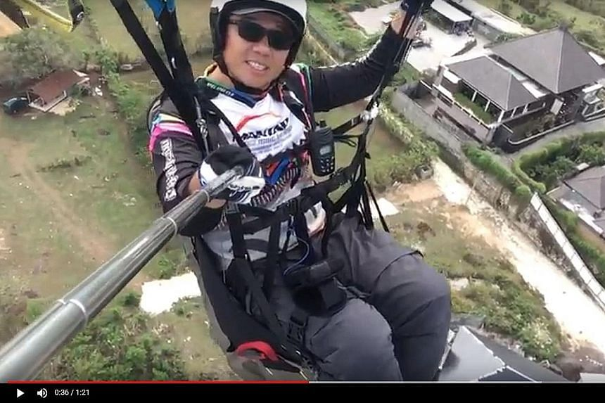 A screengrab from the video of an airborne Mr Ng Kok Choong that was shown at his wake. His daughter-in-law, Miss Priscilla Luo, said he had sometimes shared videos and photographs of his flights with the family, and this video is just something smal