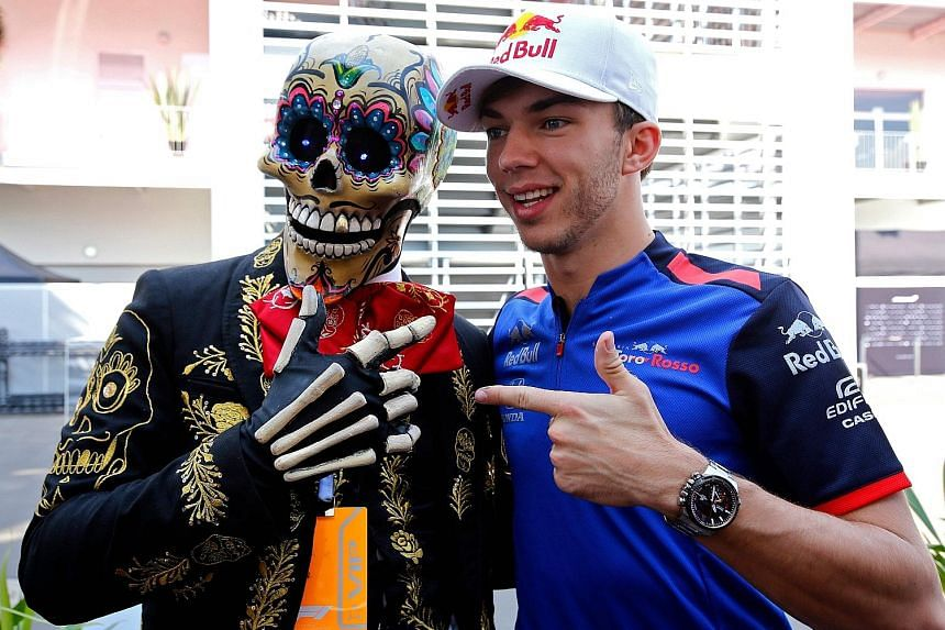 Toro Rosso's French driver Pierre Gasly hamming it up with a Day of the Dead performer.