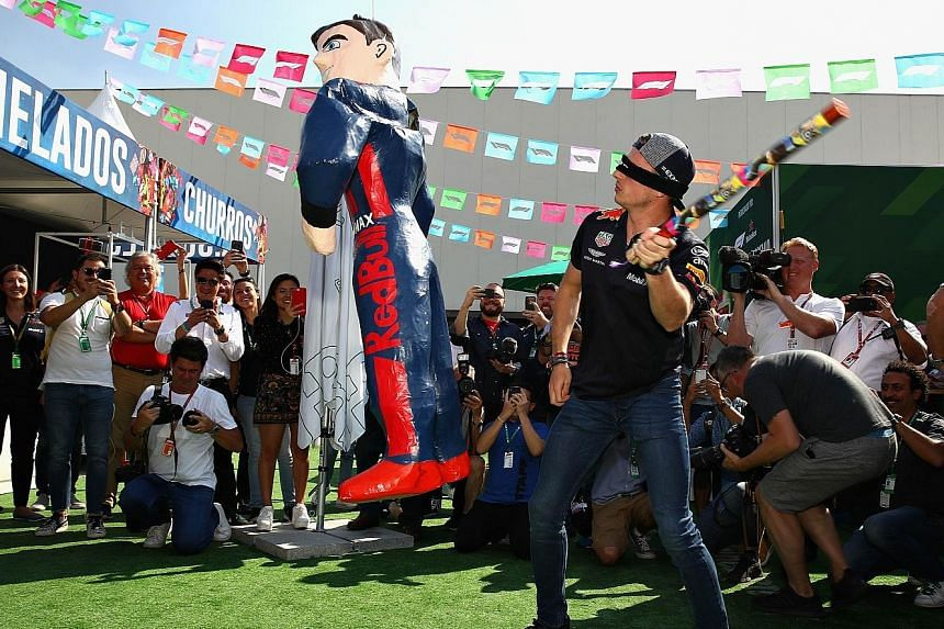 Clockwise from above: Defending champion Max Verstappen of Red Bull attempting to smash a pinata in the paddock during the Mexican Grand Prix festivities on Thursday.