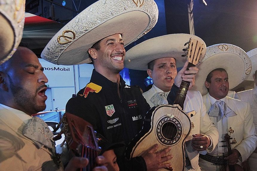 His Australian teammate Daniel Ricciardo donning a sombrero and playing a guitar with Mexican mariachis at the Autodromo Hermanos Rodriguez.