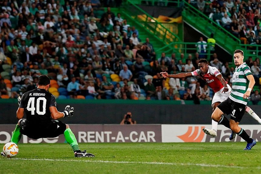 Arsenal's Danny Welbeck scoring the only goal of the game against Sporting. It was the Portuguese side's first loss at the Estadio Jose Alvalade in Lisbon in over a year.