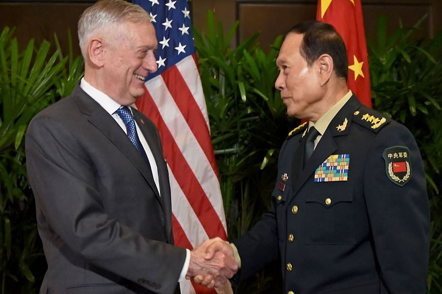 US Defence Secretary James Mattis with his Chinese counterpart Wei Fenghe during a meeting on the sidelines of the Asean security summit in Singapore on Oct 18, 2018.