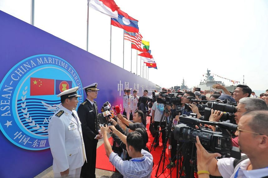 Exercise co-directors Colonel Lim Yu Chuan from the Republic of Singapore Navy and Senior Captain Zhu Jianda, commander of the People's Liberation Army Combat Support Flotilla, Southern Theatre Command, speaking to the media at the closing ceremony o