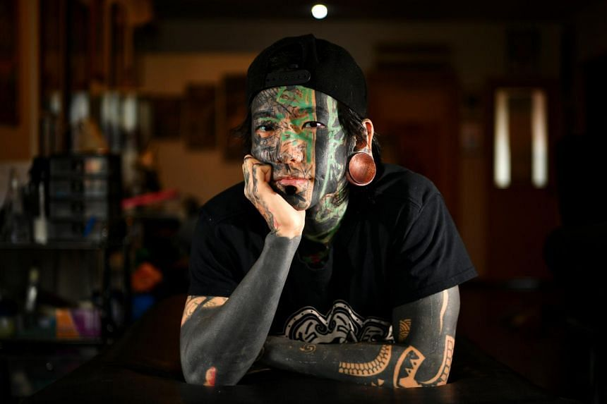 Mr Akira Ong, who had a full face tattoo done this year, took a few days to get used to it.
