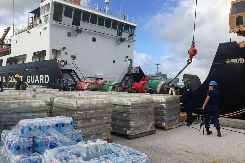 Supplies being loaded onto a ship at Apra Harbor in Guam before it sets sail to Saipan in the Northern Mariana Islands, to help those affected by Super Typhoon Yutu, on Oct 27, 2018.