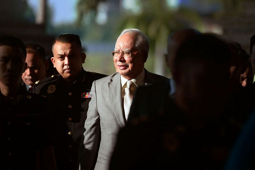 Malaysia's former prime minister Najib Razak being escorted by police to the courthouse in Kuala Lumpur on Oct 25, 2018.