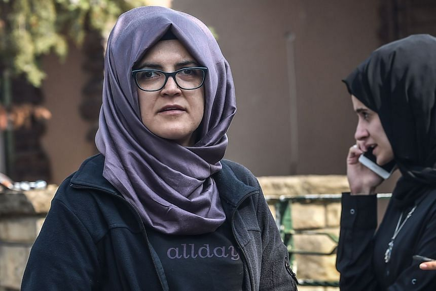 Hatice Cengiz (left) and her friend wait in front of the Saudi Arabian consulate in Istanbul, on Oct 3, 2018.