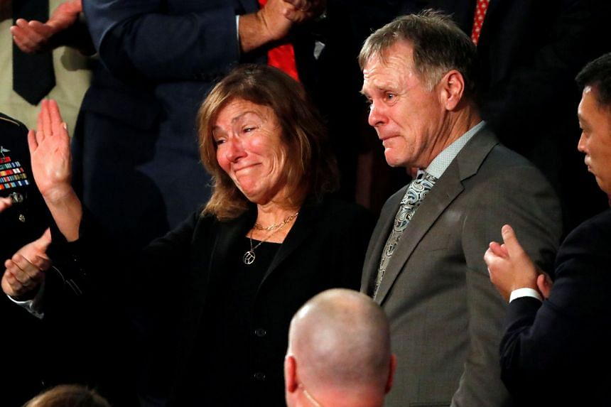 Otto Warmbier's parents Fred and Cindy cry as US President Donald Trump talks about the death of their son.