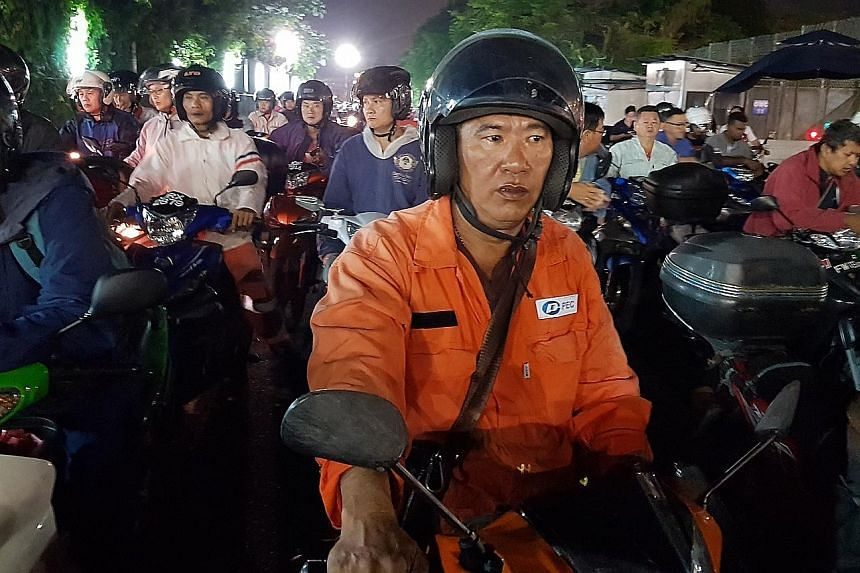 Malaysian Yap Boon Hock, 50, wakes up at 4.30am to ride from his rented home in Johor Baru to Pasir Panjang in Singapore, where he works as a welder. This has been his daily routine for the last 20 years and he is used to jams, long delays and having