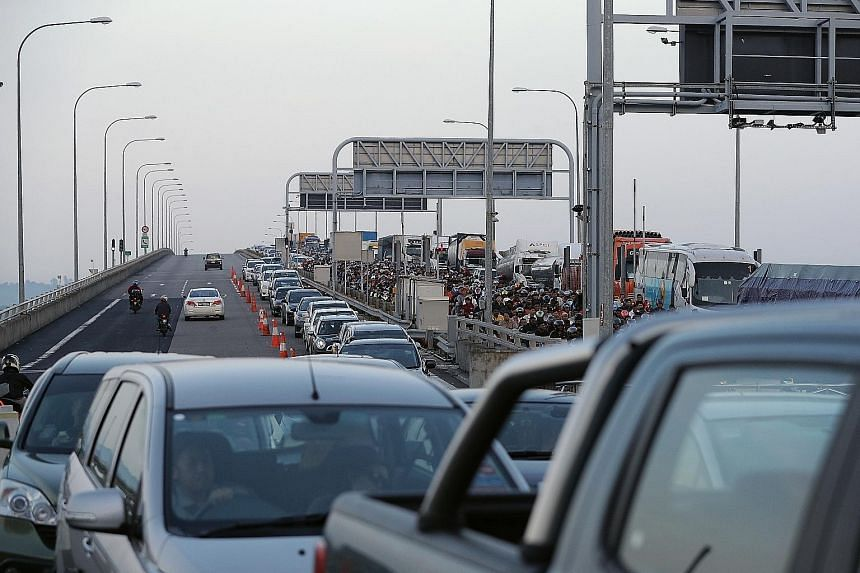 At the Tuas checkpoint, queues can be especially long during festive seasons and the wait to get across could stretch for hours. View of the Pasir Gudang industrial area in Johor from Punggol Point. The suggestion of a new bridge leading to Malaysia