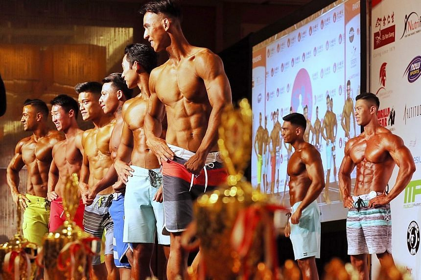 Contestants in the men's physique junior final posing on stage at the Show of Strength Singapore 2018 at Marina Bay Sands yesterday.