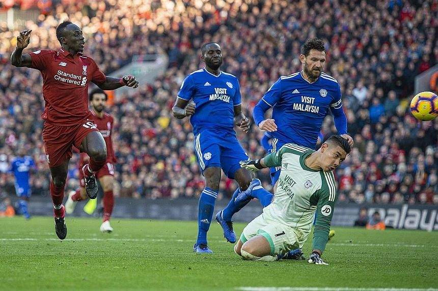 Sadio Mane finishing off an afternoon's work with his second goal to wrap up the 4-1 English Premier League drubbing of Cardiff City at Anfield.