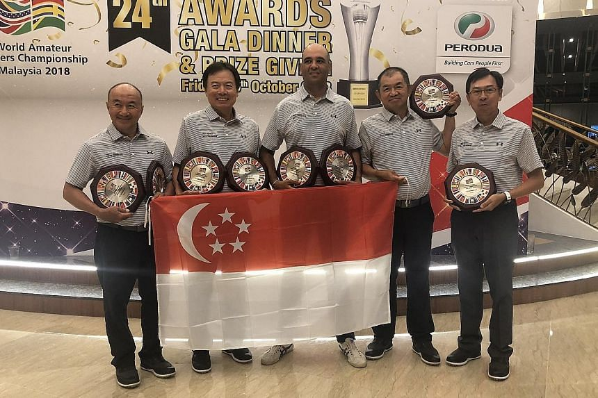 Singapore's (from left) Ricky Huang, Patrick Low, Samir Bedi, Teo Hock Guan and Ong Siew Yong with their trophies after finishing second at the World Amateur Golf Championships World Finals.