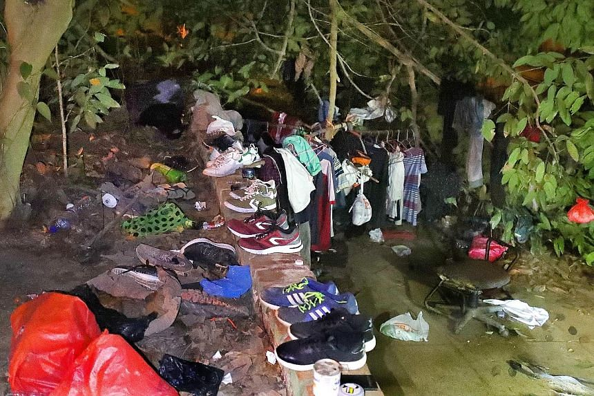 Clothes, shoes and rubbish found at a makeshift hideout below an expressway in Bukit Panjang during last Wednesday's police operation.