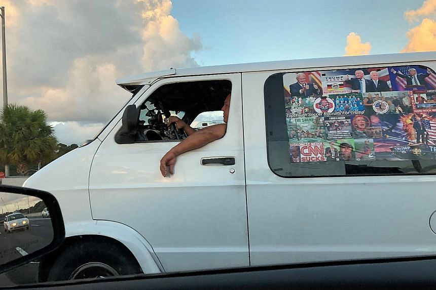 Cesar Sayoc being escorted from an FBI facility in Florida last Friday, after he was arrested. The authorities say he was responsible for sending at least 13 potential explosive devices to prominent Democratic and media figures in recent days. PHOTO: