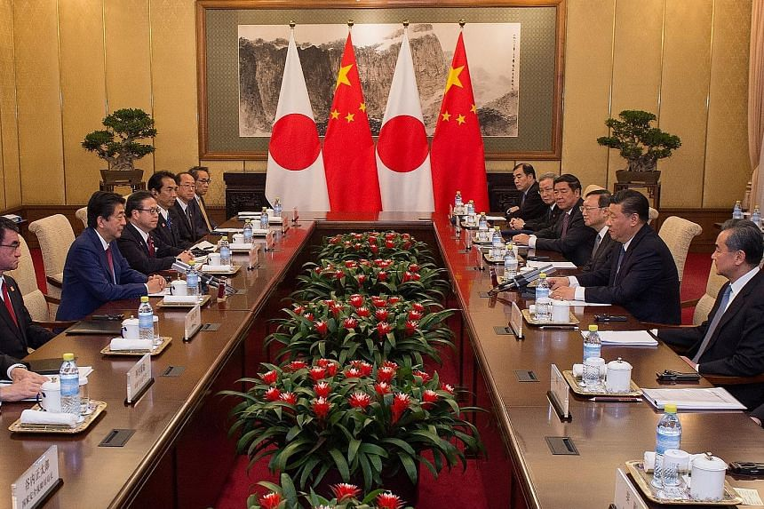 Japanese Prime Minister Shinzo Abe speaking with Chinese President Xi Jinping during a meeting at the Diaoyutai State Guesthouse in Beijing last Friday. Mr Abe is due to welcome Indian Prime Minister Narendra Modi today.
