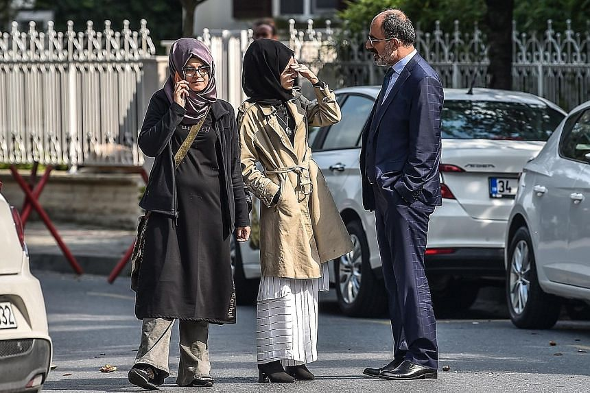 Journalist Jamal Khashoggi's fiancee, Ms Hatice Cengiz (left), and her friends waiting at the Saudi Arabian consulate in Istanbul on Oct 3, a day after he disappeared.