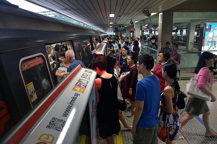 Rush hour at Ang Mo Kio MRT Station. As part of the SMRT initiative, music has usually played near gantries where commuters enter and exit. Instrumental piped music can help counter negative emotions experienced during stressful situations while comm