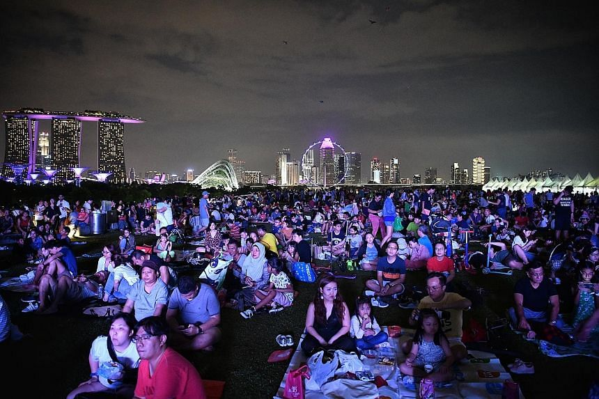 Visitors at the Marina Barrage 10th Anniversary Celebrations gathered at the Green Roof yesterday to enjoyperformances such as the LED water percussion, a sand art video show by artist Stacey Lee and a fireworks display. They also saw the unveiling o