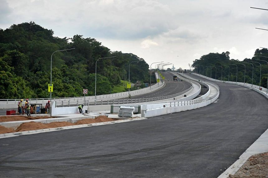 The first section of the Lornie Highway - previously known as the Bukit Brown Road - was finally opened to traffic at 3am on Sunday (Oct 28).