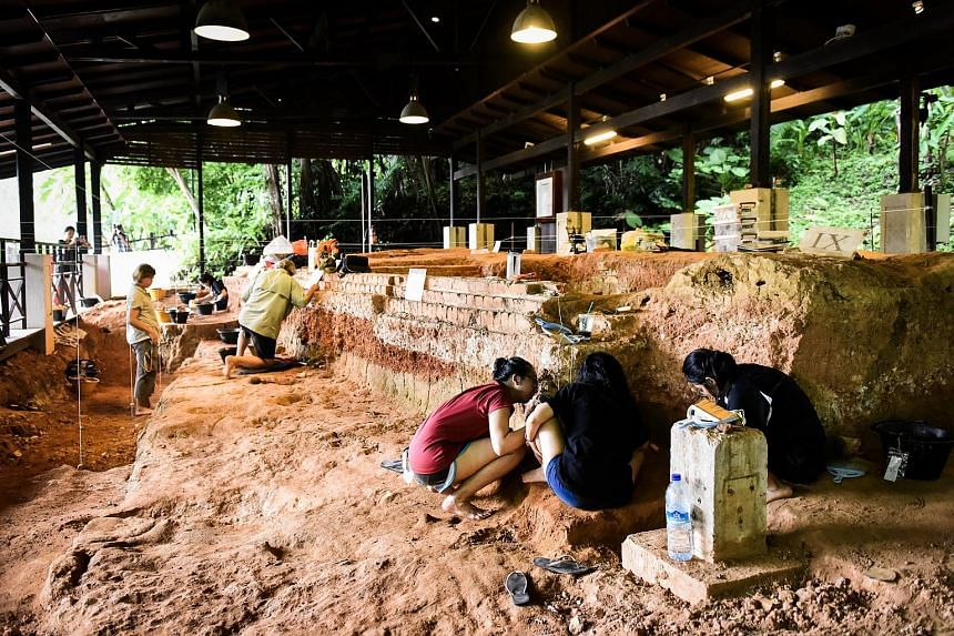 Members of an archaeological team working at a dig site in Fort Canning Park on Oct 28, 2018.